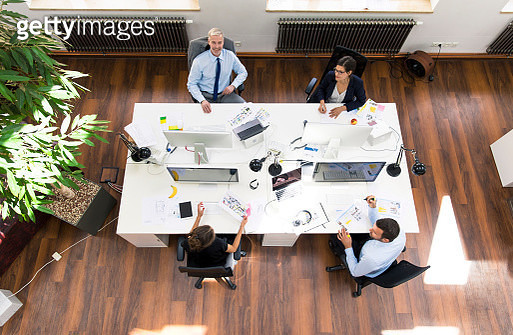 Business people in planning office sitting at desk, working together - gettyimageskorea