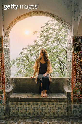 Young Caucasian woman in Mahamuni Buddha Temple in Mandalay at sunset - gettyimageskorea