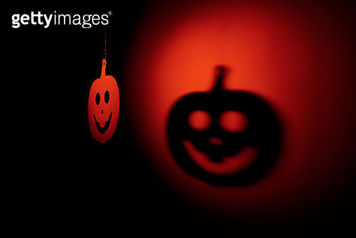 Wooden Pumpkin Decoration Hanging Against Shadow On Wall During Halloween - gettyimageskorea