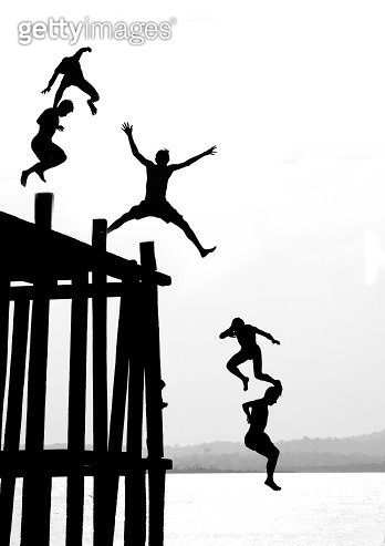 Kids jumping from wharf on Tapajos River - gettyimageskorea
