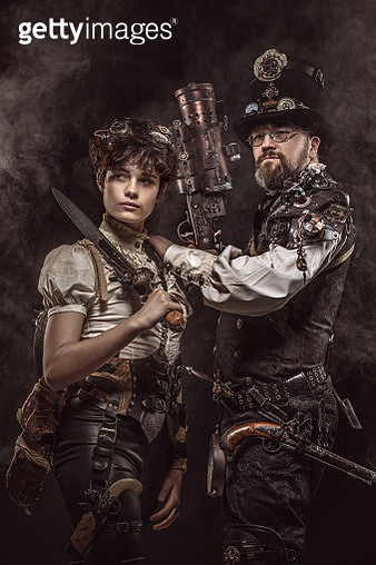 Steampunk couple of male and female enthusiasts in a studio shot - gettyimageskorea