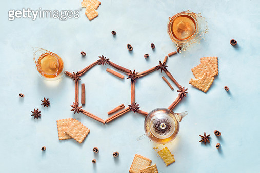 Serotonin molecule made out of cinnamon and teacups with splashes. Creative drink flat lay with the hormone of joy. - gettyimageskorea