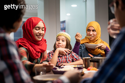 Family eating Iftar and enjoying breaking of fasting - gettyimageskorea