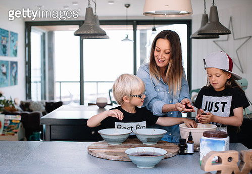 Children baking in the kitchen handling food with mother - gettyimageskorea