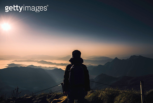 silhouette man at peak of mountains - gettyimageskorea