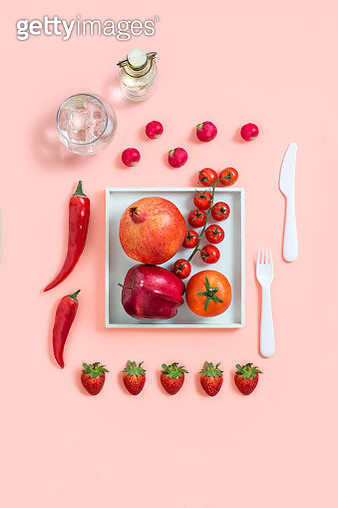 Various red colour fruits and vegetables on purple background. - gettyimageskorea
