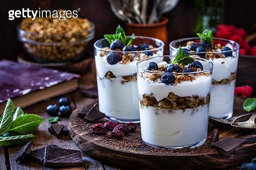 Yogurt with granola, berry fruits and chocolate - gettyimageskorea