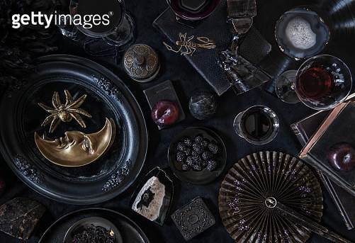 Dark still life with books, red wine, and antiques - gettyimageskorea