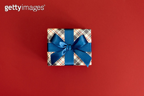 Christmas gifts presents on red background. Simple, classic, red and white wrapped gift boxes with ribbon bows and festive holiday decorations - gettyimageskorea
