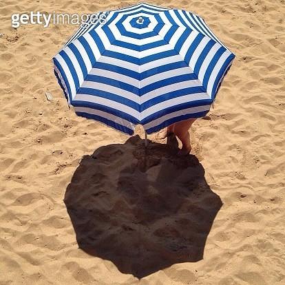 Woman On Beach Under Umbrella - gettyimageskorea