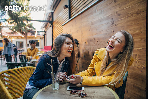 Friends sitting at cafe and drinking coffee - gettyimageskorea