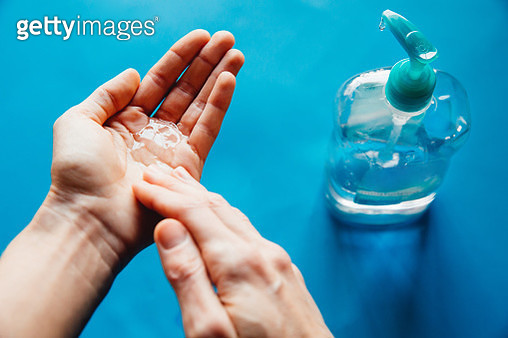 Woman disinfecting hands during the Coronavirus pandemic, also known as covid19 - gettyimageskorea