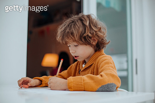 boy doing some homeworks - gettyimageskorea