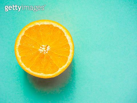 Close-Up Of Orange Against Turquoise Background - gettyimageskorea