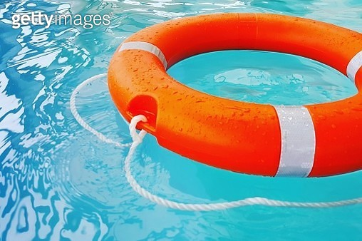Close-Up Of Life Belt Floating On Swimming Pool - gettyimageskorea