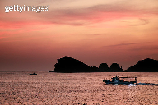 Fishing Boat crossing in the Twilight - gettyimageskorea