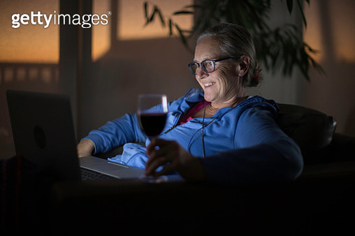 Mature woman on a video call from her laptop during lockdown - gettyimageskorea