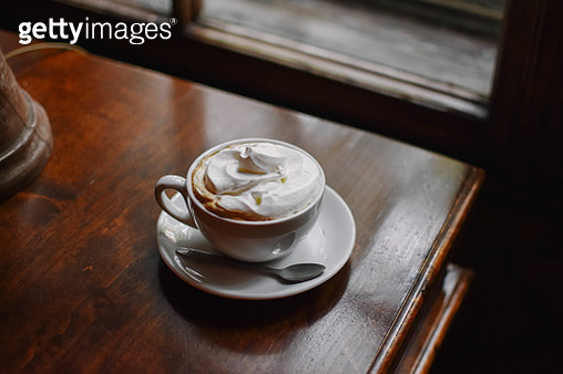 High Angle View Of Coffee Served On Wooden Table In Cafe - gettyimageskorea