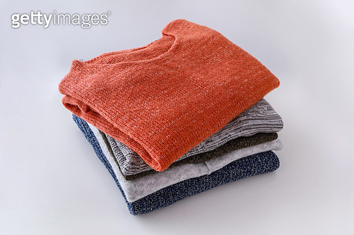 High Angle View Of Sweaters Against White Background - gettyimageskorea