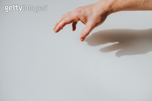 Human hand against white background. Conceptual with space for copy or additional design. - gettyimageskorea