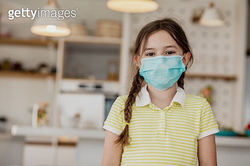 Little girl smiling with face mask indoors - gettyimageskorea