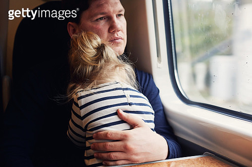 Father and daughter on a train - gettyimageskorea