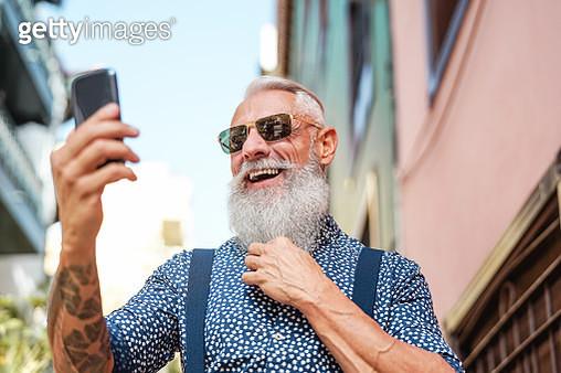Bearded Senior Using Mobile Phone Outdoor - gettyimageskorea