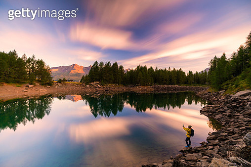 Hiker snaps pictures at Lago Azzurro, Madesimo - gettyimageskorea