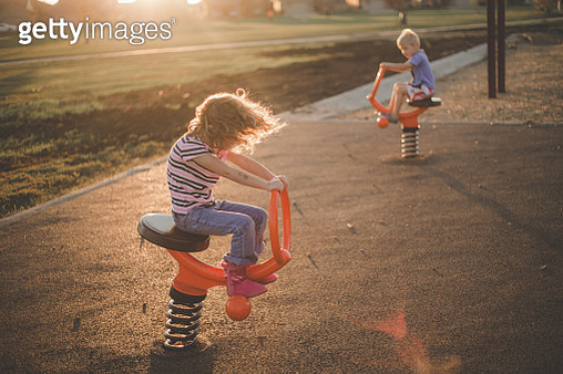 Kids Playing at a Playground - gettyimageskorea