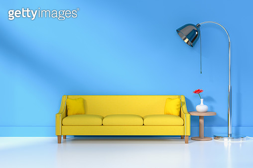Yellow Sofa Against Blue Wall At Home - gettyimageskorea