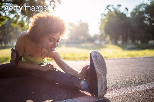 Young woman stretching body after jogging - gettyimageskorea
