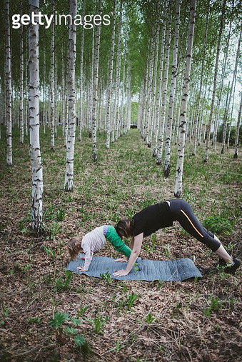 Exercise with child in forest - gettyimageskorea
