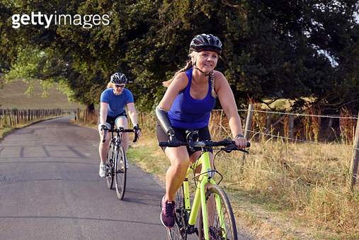 Women cyclists, one amputee - gettyimageskorea