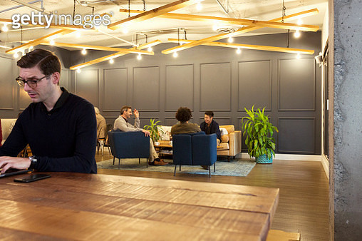 Creative business people having meeting in modern open plan office - gettyimageskorea