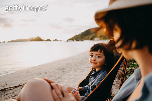 Cute mixed race toddler girl with mother on beach, Okinawa, Japan - gettyimageskorea
