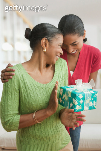 Daughter giving mother gift - gettyimageskorea