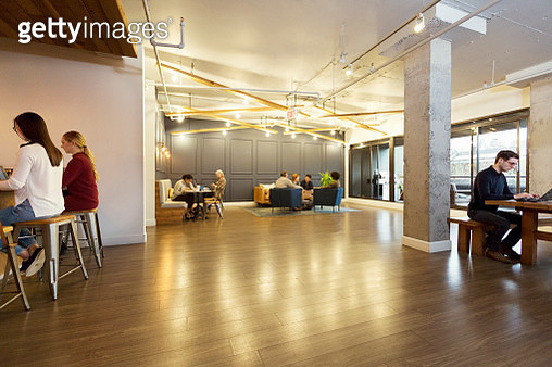 Creative business people working in modern open plan office - gettyimageskorea