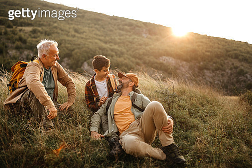 Happy three generations males relaxing on hiking tour - gettyimageskorea