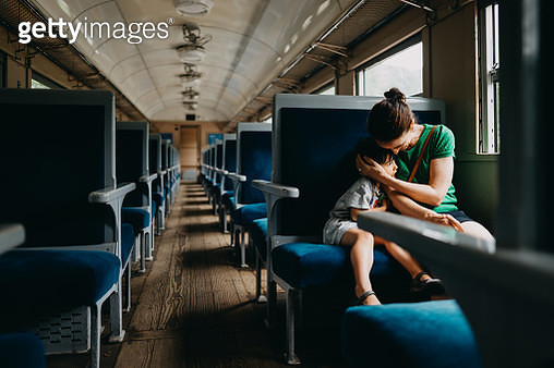 Mother and child having intimate moment in train - gettyimageskorea