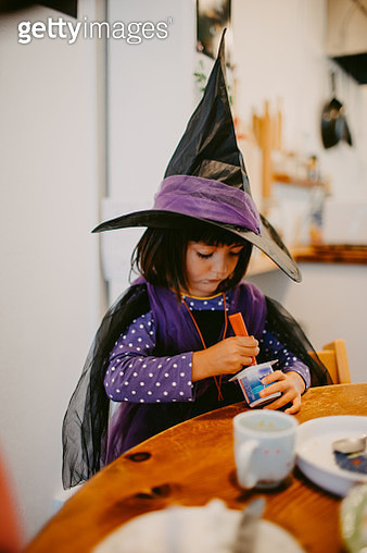 Child having breakfast with halloween witch costume - gettyimageskorea