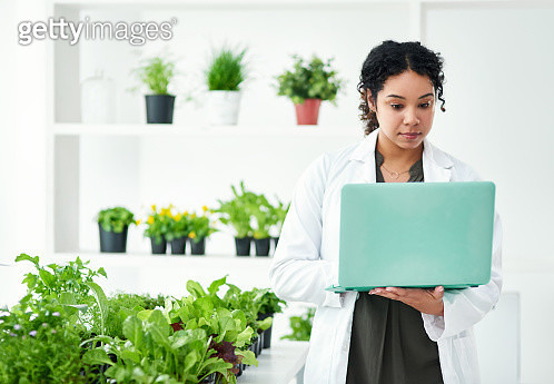 Shot of a scientist using a laptop while working in a lab - gettyimageskorea