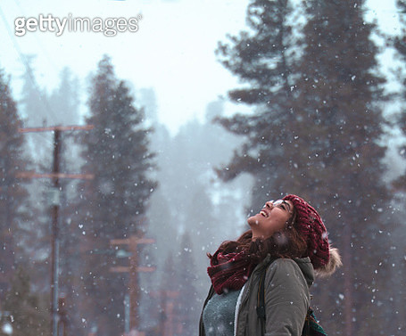 A young woman enjoys the recent snowfall - gettyimageskorea