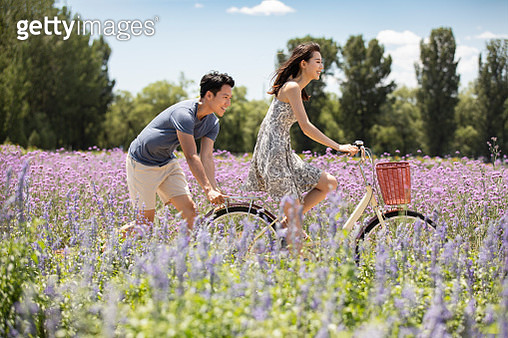 Happy young couple dating in lavender field - gettyimageskorea