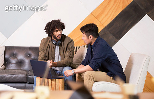 Creative businessmen having informal meeting in co-working space - gettyimageskorea