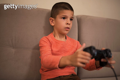 little boy playing video games - gettyimageskorea