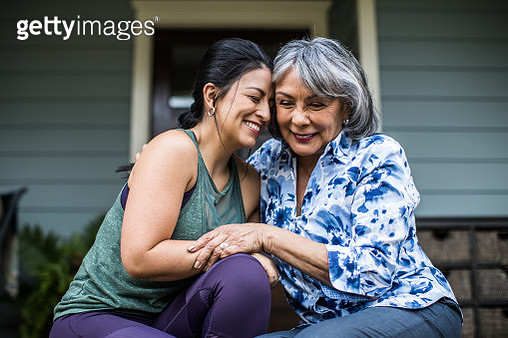 Senior woman and adult daughter laughing on porch - gettyimageskorea