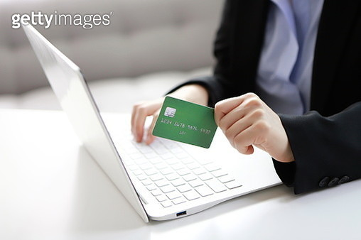 Businesswoman shopping online with credit card - gettyimageskorea