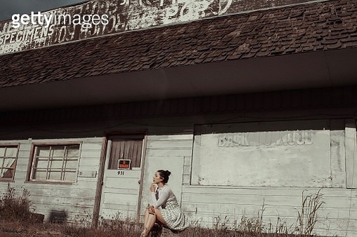 Woman Standing Against Wall In Building - gettyimageskorea