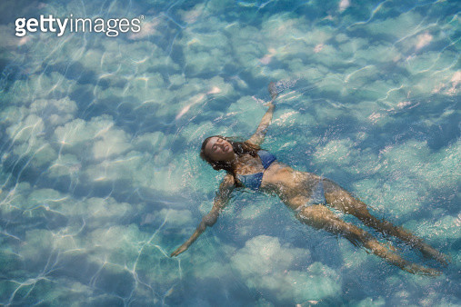 woman swimming in a pool among clouds - gettyimageskorea
