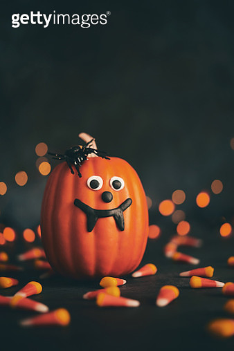 Cute pumpkin character with handmade fangs and holiday lights - gettyimageskorea